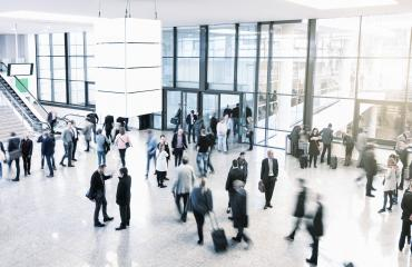 Many unrecognizable business people in a trade fair hall- Stock Photo or Stock Video of rcfotostock | RC-Photo-Stock