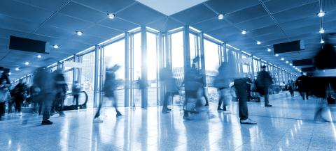 Many unrecognizable business people in a traid fair corridor- Stock Photo or Stock Video of rcfotostock | RC-Photo-Stock