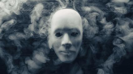 Mask with smoke on wooden background- Stock Photo or Stock Video of rcfotostock | RC-Photo-Stock