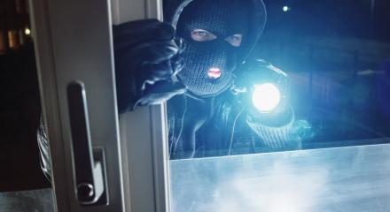 masked Burglar looking through window with flashlight at night- Stock Photo or Stock Video of rcfotostock | RC-Photo-Stock