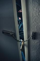 masked burglar use crowbar to breaking into a home door with chain : Stock Photo or Stock Video Download rcfotostock photos, images and assets rcfotostock | RC-Photo-Stock.: