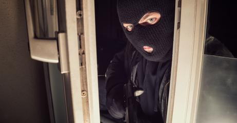 Masked burglar with gun breaking and entering into a house window - shot with dramatic motion : Stock Photo or Stock Video Download rcfotostock photos, images and assets rcfotostock | RC-Photo-Stock.: