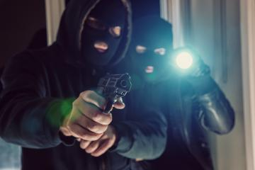 masked burglar with gun breaking and entering into a victim's home : Stock Photo or Stock Video Download rcfotostock photos, images and assets rcfotostock | RC-Photo-Stock.: