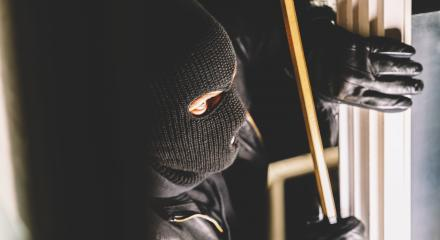 Masked burglar with torch and crowbar breaking and entering into a house : Stock Photo or Stock Video Download rcfotostock photos, images and assets rcfotostock | RC-Photo-Stock.: