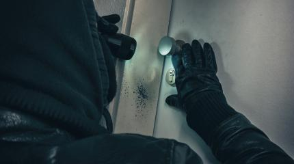 Masked burglar with torch entering into a house door - shot with dramatic motion : Stock Photo or Stock Video Download rcfotostock photos, images and assets rcfotostock | RC-Photo-Stock.: