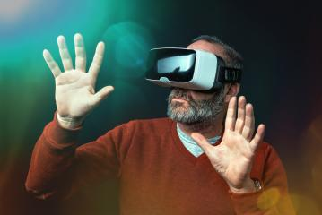 Mature business man wearing virtual reality googles / VR Glasses to work with in modern office- Stock Photo or Stock Video of rcfotostock   RC-Photo-Stock