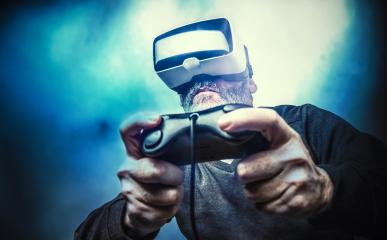 Mature man wearing virtual reality goggles / VR Glasses to play video games- Stock Photo or Stock Video of rcfotostock | RC-Photo-Stock
