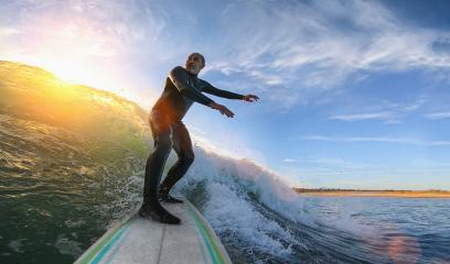Mature senior adult surfing on a big wave in the ocean : Stock Photo or Stock Video Download rcfotostock photos, images and assets rcfotostock | RC-Photo-Stock.: