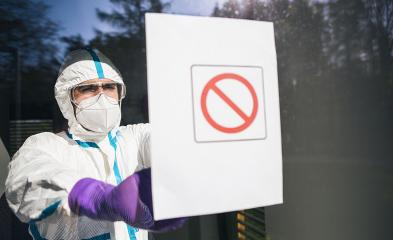 Medic seals off contaminated area during coronavirus (Coivd-19) epidemic in a clinic : Stock Photo or Stock Video Download rcfotostock photos, images and assets rcfotostock | RC-Photo-Stock.: