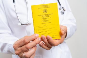 Medical Doctor showing an international certificate of the vaccination for coronavirus, covid-19 or flu, measles vaccine : Stock Photo or Stock Video Download rcfotostock photos, images and assets rcfotostock | RC-Photo-Stock.: