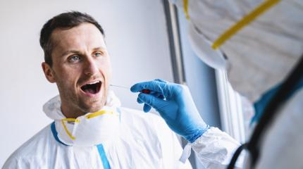 Medical professional in protective clothing takes swab test tube from mouth of a Exhausted clinician at a Covid-19 test center during coronavirus epidemic. PCR DNA testing protocol process.- Stock Photo or Stock Video of rcfotostock | RC-Photo-Stock