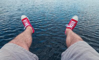 Mens legs in sneakers in background of a sea landscape Summer Beach Relaxing Concept, Point of view shot- Stock Photo or Stock Video of rcfotostock | RC-Photo-Stock