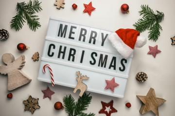 Merry Christmas displayed on a vintage lightbox with santa hat and decoration, concept image- Stock Photo or Stock Video of rcfotostock | RC-Photo-Stock