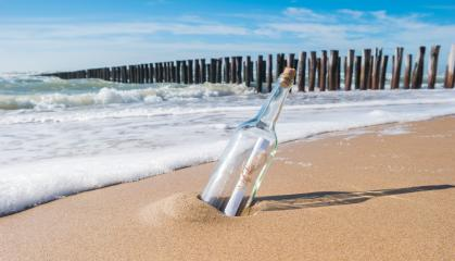Message in a bottle on beach in Zeeland, Holland- Stock Photo or Stock Video of rcfotostock | RC-Photo-Stock