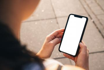 Mockup image of hand holding mobile phone with blank white screen in the city at a summer- Stock Photo or Stock Video of rcfotostock | RC-Photo-Stock