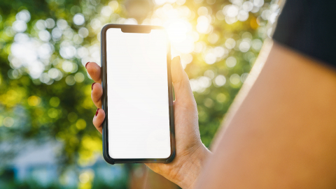 Mockup image of woman's hands holding black smartphone with white blank screen on a in the park- Stock Photo or Stock Video of rcfotostock | RC-Photo-Stock