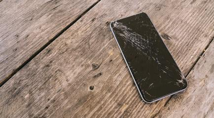 Modern mobile phone with broken screen on wooden background- Stock Photo or Stock Video of rcfotostock | RC-Photo-Stock