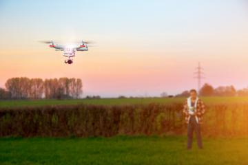 Modern RC UAV Drone / Quadcopter with camera flying on a clear sunny sky - Stock Photo or Stock Video of rcfotostock | RC-Photo-Stock