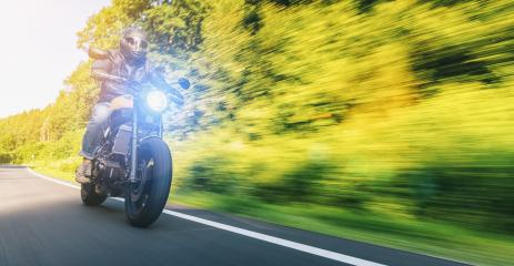 modern scrambler motorbike on the forest road riding. having fun driving the empty road on a motorcycle tour journey. Real dynamic motion blur shot. copyspace for your individual text.- Stock Photo or Stock Video of rcfotostock | RC-Photo-Stock