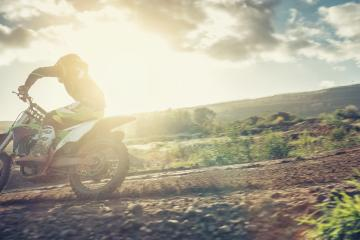Motocross MX pilot in a turn during sunset on a dirt track- Stock Photo or Stock Video of rcfotostock | RC-Photo-Stock