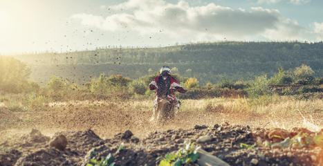 motocross MX Safari motorcycle on a dirt track with beautiful landscape- Stock Photo or Stock Video of rcfotostock | RC-Photo-Stock