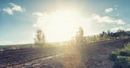 Motocross rider on a dirt track a sunset- Stock Photo or Stock Video of rcfotostock | RC-Photo-Stock