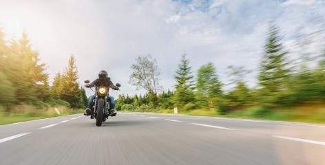 motorbike chopper on the road riding. having fun driving the empty road on a motorcycle tour. copyspace for your individual text.- Stock Photo or Stock Video of rcfotostock   RC-Photo-Stock