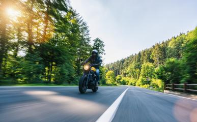 motorbike on the Alpine highway riding. having fun driving the empty road on a motorcycle tour journey. copyspace for your individual text.- Stock Photo or Stock Video of rcfotostock | RC-Photo-Stock