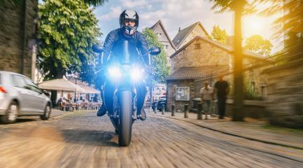 motorbike on the city road riding. having fun driving in a town road on a motorcycle tour journey : Stock Photo or Stock Video Download rcfotostock photos, images and assets rcfotostock | RC-Photo-Stock.: