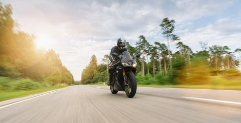 motorbike on the country road riding with motion speed. driving on the empty road on a motorcycle tour. copyspace for your individual text.- Stock Photo or Stock Video of rcfotostock | RC-Photo-Stock