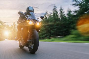 motorbike on the forest road riding at sunset. driving on the empty road on a motorcycle trip. copyspace for your individual text.- Stock Photo or Stock Video of rcfotostock | RC-Photo-Stock