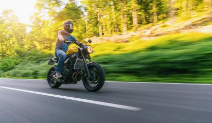 motorbike on the forest road riding at sunset. having fun driving the empty road on a motorcycle tour journey. copyspace for your individual text.- Stock Photo or Stock Video of rcfotostock | RC-Photo-Stock