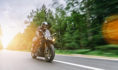 motorbike on the forest road riding. driving on the empty road on a motorcycle tour at sunset. copyspace for your individual text.- Stock Photo or Stock Video of rcfotostock | RC-Photo-Stock