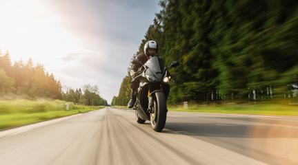 motorbike on the forest road riding. driving on the empty road on a motorcycle tour. copyspace for your individual text.- Stock Photo or Stock Video of rcfotostock | RC-Photo-Stock
