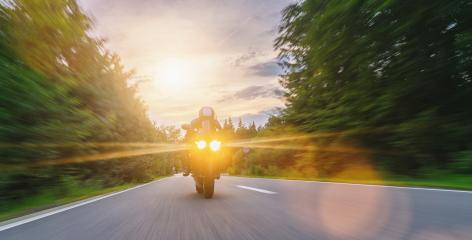 motorbike on the forest road riding. driving on the empty road on a motorcycle tour at sunset. copyspace for your individual text. : Stock Photo or Stock Video Download rcfotostock photos, images and assets rcfotostock | RC-Photo-Stock.: