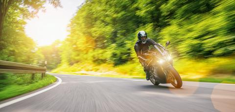 motorbike on the forest road riding fast. having fun driving on the empty road. : Stock Photo or Stock Video Download rcfotostock photos, images and assets rcfotostock | RC-Photo-Stock.: