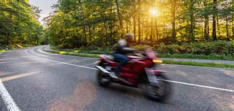 motorbike on the forest road riding fast. having fun driving the empty road on a motorcycle tour journey. copyspace for your individual text.- Stock Photo or Stock Video of rcfotostock | RC-Photo-Stock