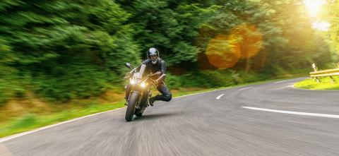 Motorbike on the forest road riding. having fun driving the empty road on a motorcycle tour journey. copyspace for your individual text. - Stock Photo or Stock Video of rcfotostock | RC-Photo-Stock