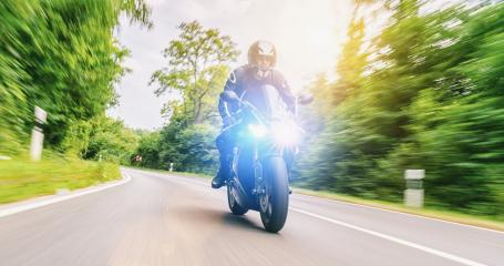 motorbike on the forest road riding. having fun driving the empty road on a motorcycle tour journey- Stock Photo or Stock Video of rcfotostock | RC-Photo-Stock