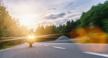 motorbike on the forest road riding with motion speed. driving on the empty road on a motorcycle tour at sunset. copyspace for your individual text.- Stock Photo or Stock Video of rcfotostock | RC-Photo-Stock