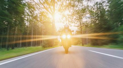 motorbike on the forest road riding with spotlights. driving on the empty road on a motorcycle tour at sunset. copyspace for your individual text. : Stock Photo or Stock Video Download rcfotostock photos, images and assets rcfotostock | RC-Photo-Stock.:
