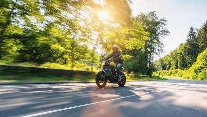 motorbike on the highway riding. having fun driving the empty road on a motorcycle tour. copyspace for your individual text.- Stock Photo or Stock Video of rcfotostock | RC-Photo-Stock
