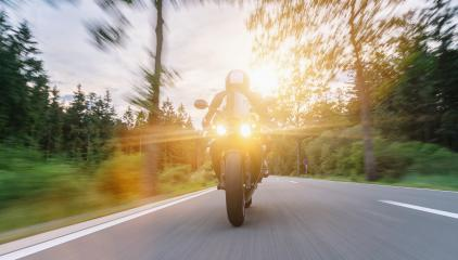 motorbike on the road riding at sunset. driving on the empty road on a motorcycle trip. copyspace for your individual text.- Stock Photo or Stock Video of rcfotostock | RC-Photo-Stock
