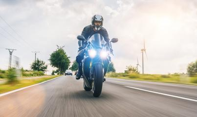 motorbike on the road riding fast. having fun driving the empty road on a motorcycle tour journey. - Stock Photo or Stock Video of rcfotostock | RC-Photo-Stock