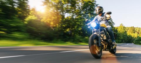 motorbike on the road riding. having fun driving the empty highway on a motorcycle tour journey - Stock Photo or Stock Video of rcfotostock | RC-Photo-Stock