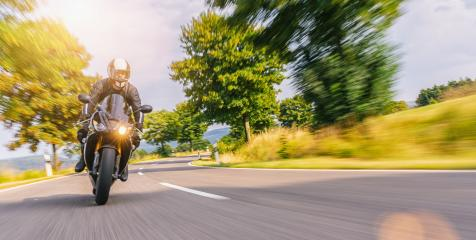 motorbike on the road riding. having fun driving the empty road on a motorcycle tour journey. copyspace for your individual text. : Stock Photo or Stock Video Download rcfotostock photos, images and assets rcfotostock | RC-Photo-Stock.: