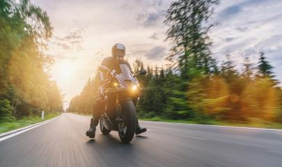 motorbike on the road riding with motion speed. driving on the empty road on a motorcycle tour at sunset. copyspace for your individual text. : Stock Photo or Stock Video Download rcfotostock photos, images and assets rcfotostock | RC-Photo-Stock.: