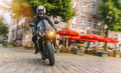 motorbike riding at a town road. driving on road on a motorcycle tour at summer- Stock Photo or Stock Video of rcfotostock | RC-Photo-Stock