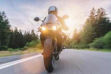motorbike riding at sunset driving on the empty road on a motorcycle trip. copyspace for your individual text. : Stock Photo or Stock Video Download rcfotostock photos, images and assets rcfotostock | RC-Photo-Stock.: