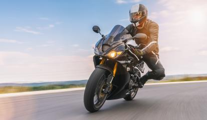 motorbike riding on road in a curve. driving on the empty road on a motorcycle trip. copyspace for your individual text.- Stock Photo or Stock Video of rcfotostock | RC-Photo-Stock